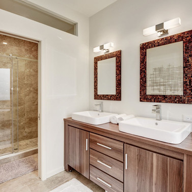 Owner's suite in penthouse has dual vanities and 6' custom shower