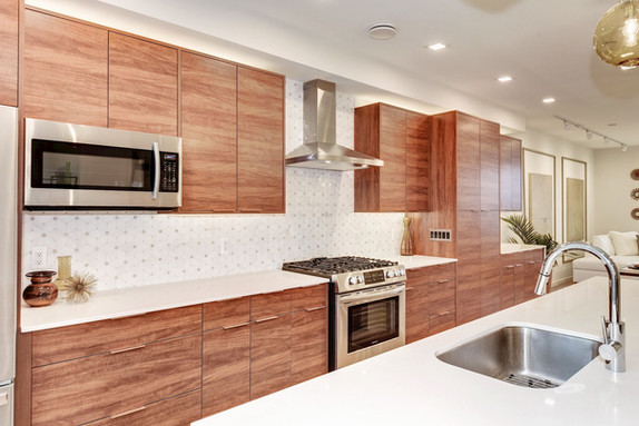 Custom kitchen with many drawers and pullouts.