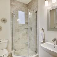 Full bath on living level of penthouse