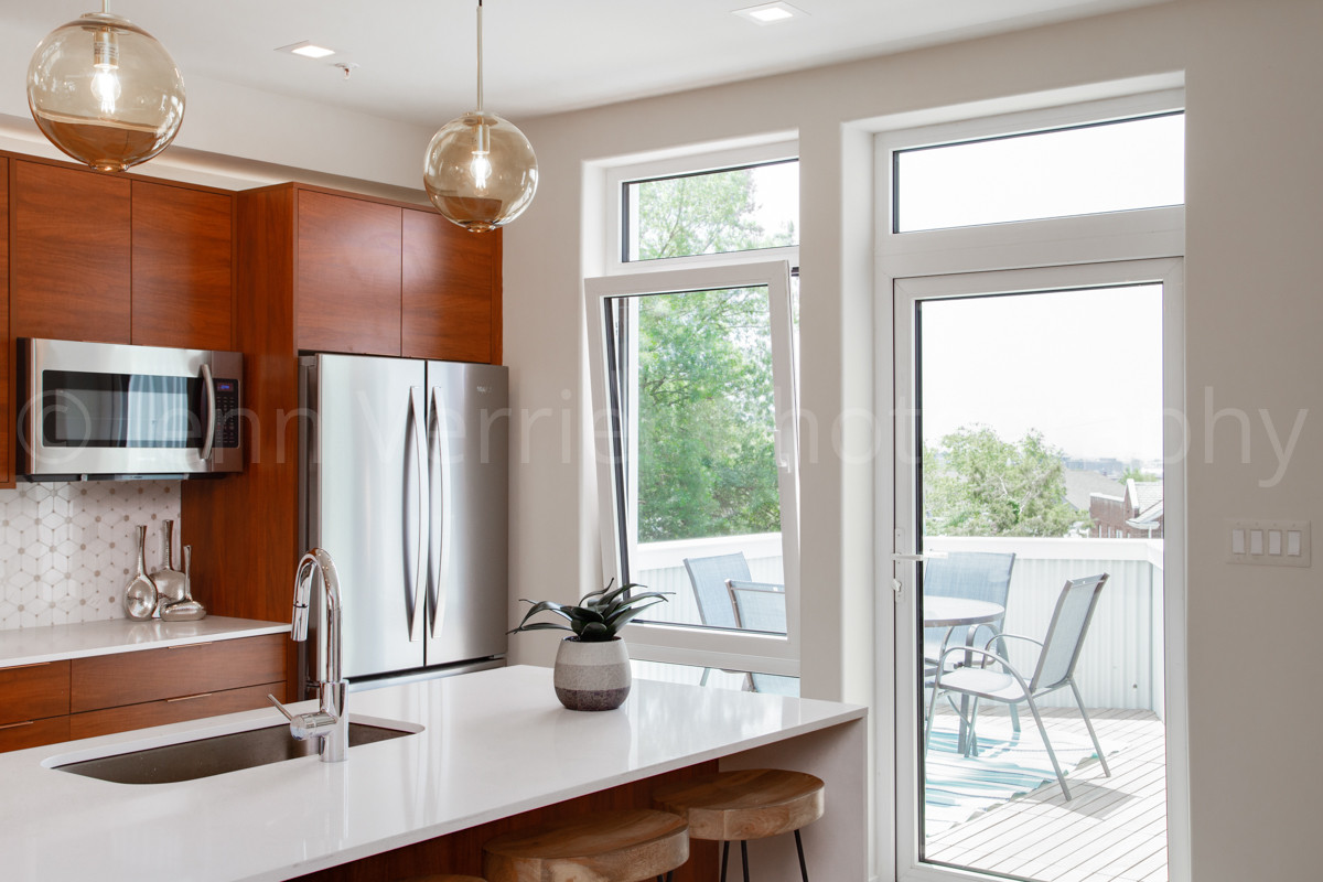 Penthouse kitchen has walk out deck for al fresco sunset dining