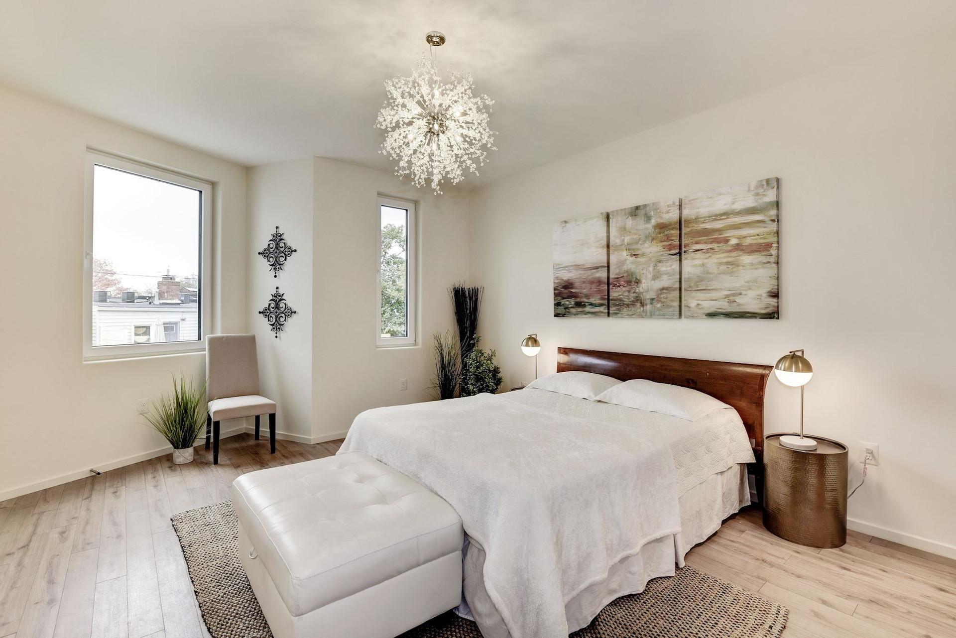 15'x13' bright master bedroom.