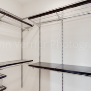 Penthouse owner's suite with custom Elfa closet system