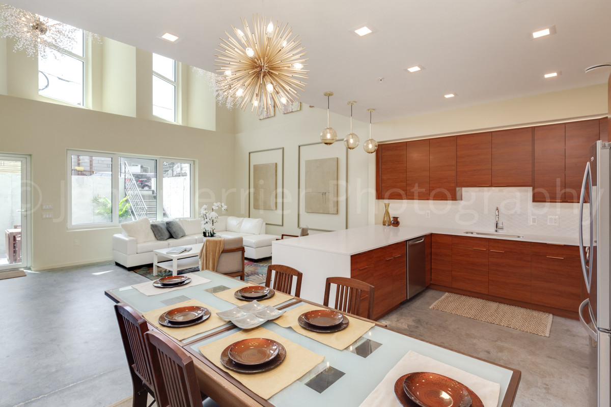 Lower unit open floor plan with dramatic windows