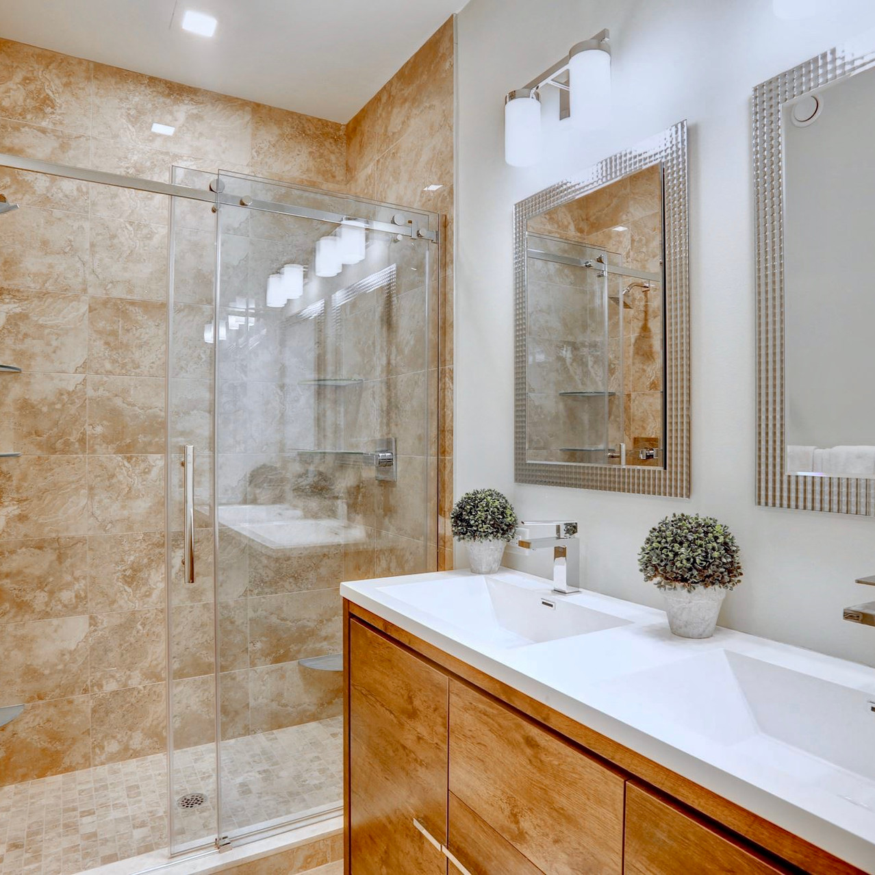 Lower owner's suite with dual vanity and 6' shower