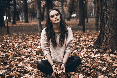 Young Adult Looking Sad on the ground in
