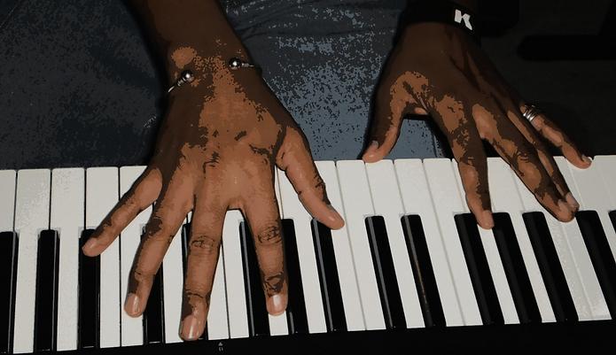 Reginald K.Son Hands on Keyboard