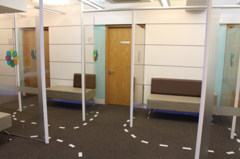 Screens separating consultation rooms