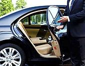 upscale limousine service driver opening door