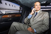 executive in backseat of a limo at private airport