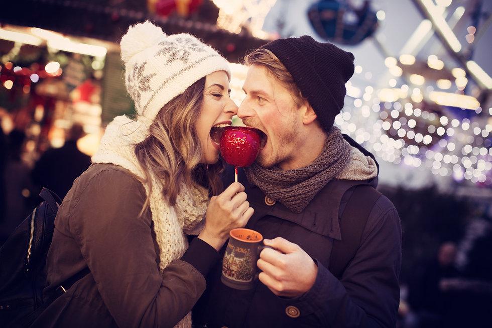 Couple eating toffee apple.jpeg