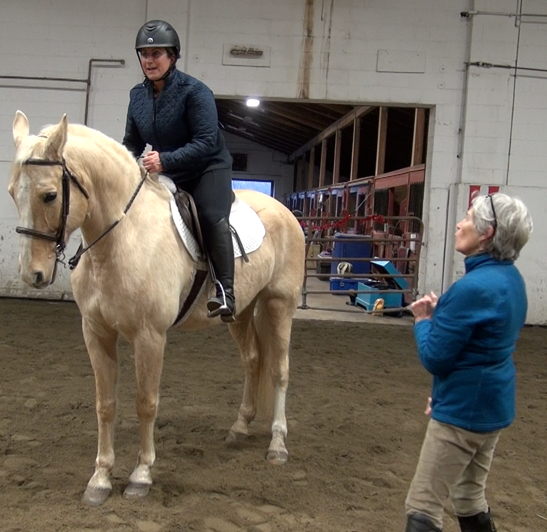Page teaching Julie, riding Gunner