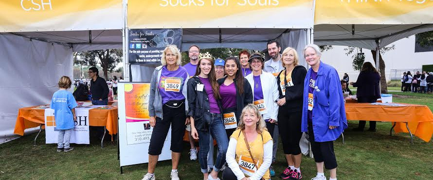 Sock Drive at our Community Partner booth with HomeWalk