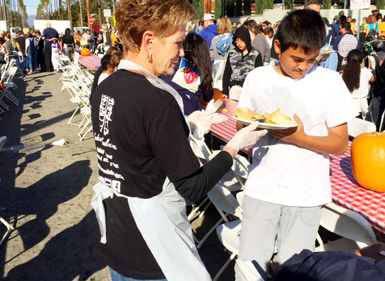 One of our volunteers serving pie