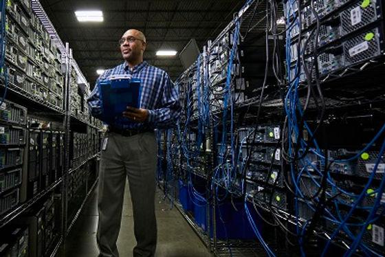 buy-back- program-person-in-server-room.