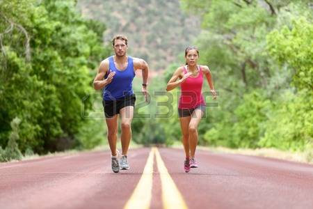 man and woman training for half marathon