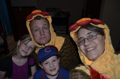 Ellie invited us to a party in her room so we snuck on our Chicken Suits first.