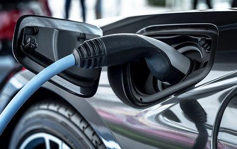 electric-car-at-charging-station_edited.jpg