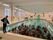 Swim Team posing after a swim session