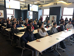 Students at college seminar