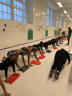 Students exercising before swimming