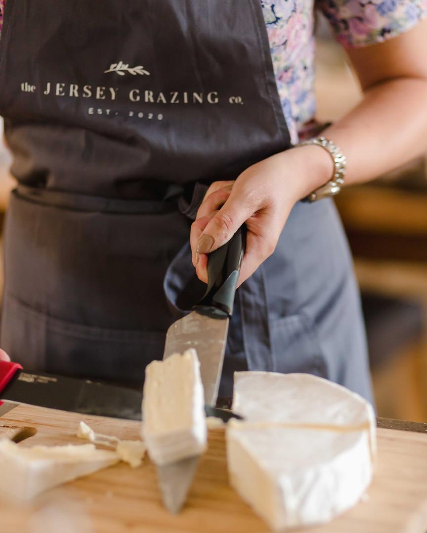 Laura-cutting-cheese.jpg
