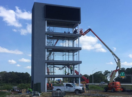 Nissan Dealer Selects SLIMPACT® Frameless Impact Windows for New Car Tower in Melbourne, FL