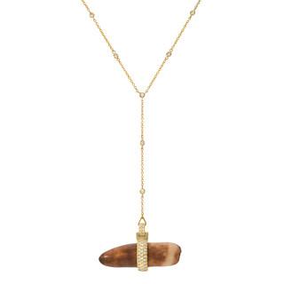 Fossil and diamond pendant