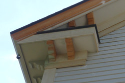 OG Profile mitered into wood rake with horizontal return