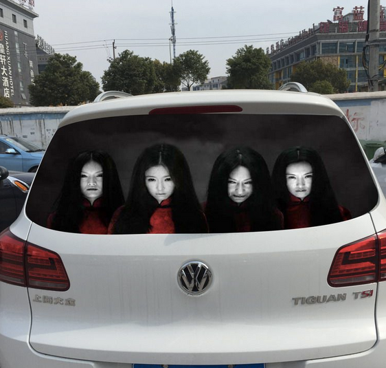 Chinese Drivers Are Using Terrifying Decals On their Rear Windshields to Deal with High-Beam Followe