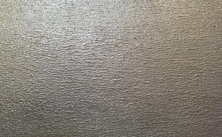 Enduit ciment métal