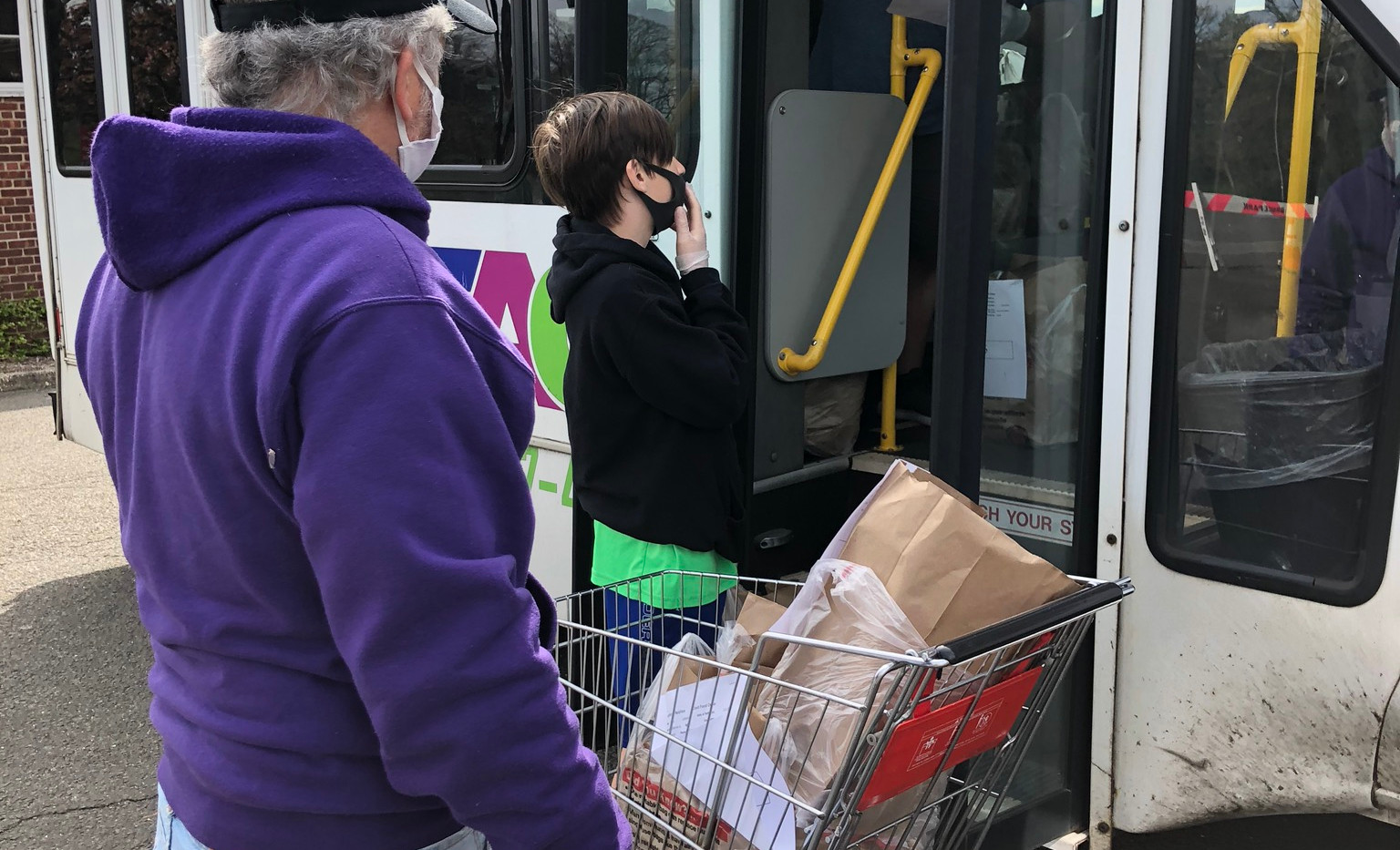 TAG volunteers load the TAG van with food