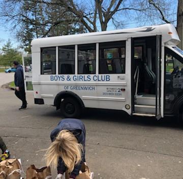 Loading van with food