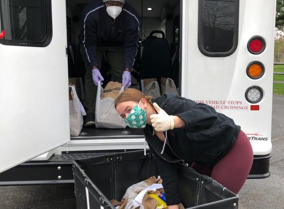 Thony and Megan, TAG volunteers load groceries in the TAG van