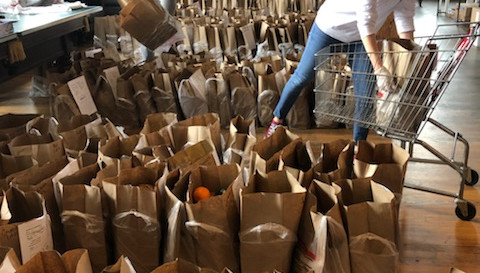 Hundreds of bags of groceries ready to tbe loaded on TAG vans