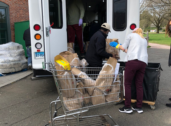 Loading groceries and meals in TAG van to deliver to seniors and disabled residents