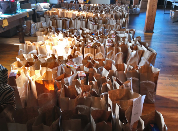 Hundreds of bags of groceries ready to be loaded on TAG vans