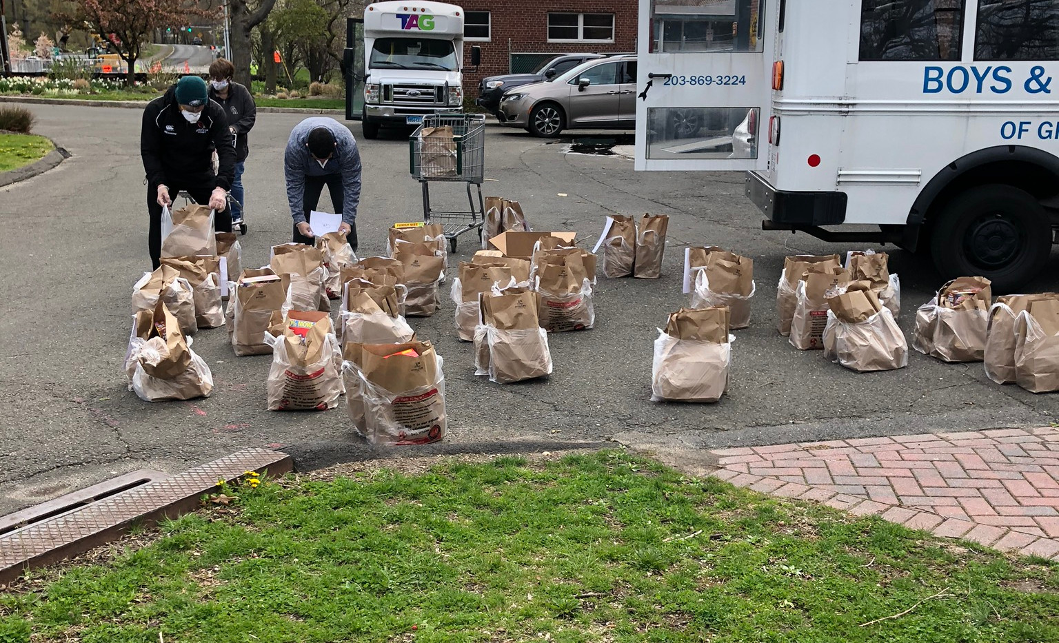 Bags of groceries ready to be loaded in TAG van