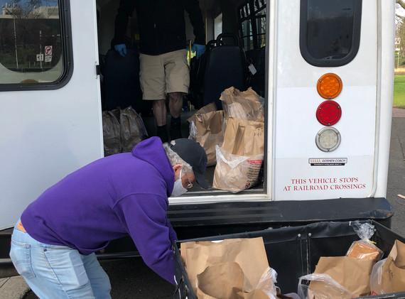 Jim, a TAG Volunteeer, helps load the TAG van with groceries