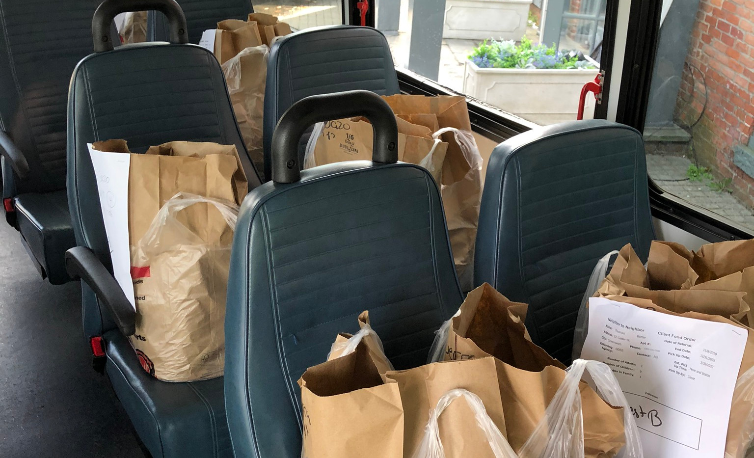 TAG van full of groceries ready for delivery to homebound seniors and disabled residents.