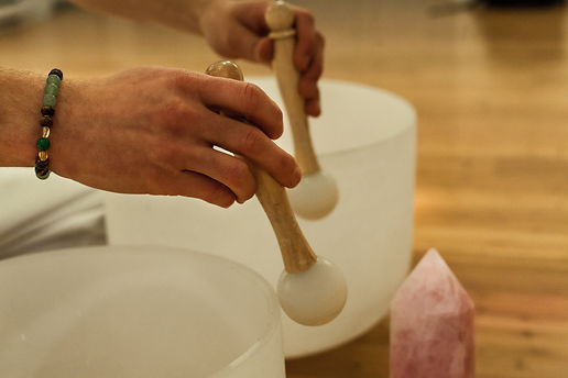 Man playing crystal bowls as part of a m