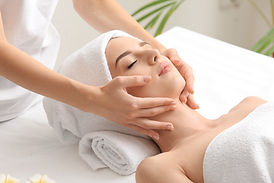Young woman having facial massage in bea