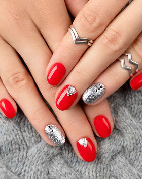 Woman's hands with fashionable red manic