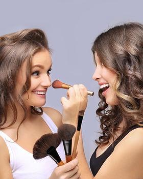 Female friends putting makeup .jpg