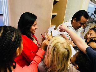 hermanas garcia taking autographs .jpg