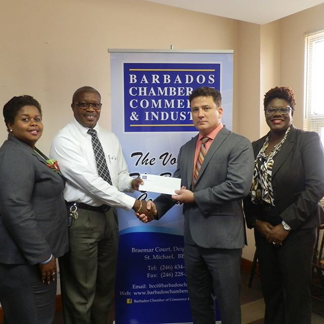 Receiving a donation from the Barbados Chamber of Commerce & Industry
