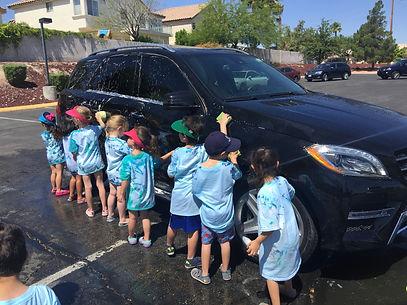Preschool Age Children Washing A Car