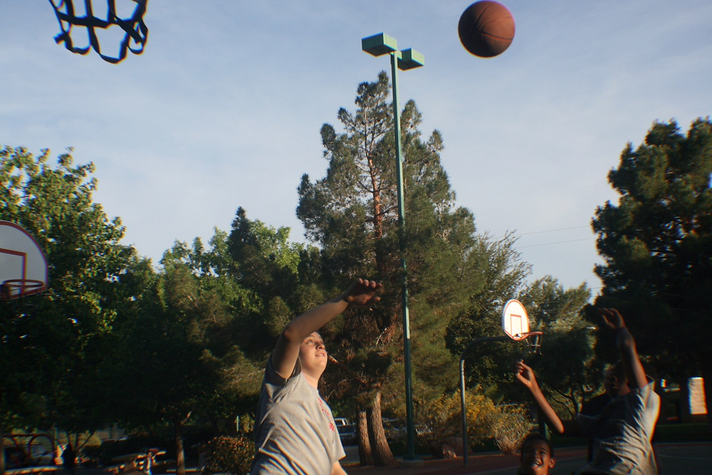 USY students play basketball with families from Family Promise