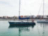 Saliendo del puerto velero Escuela Náutica
