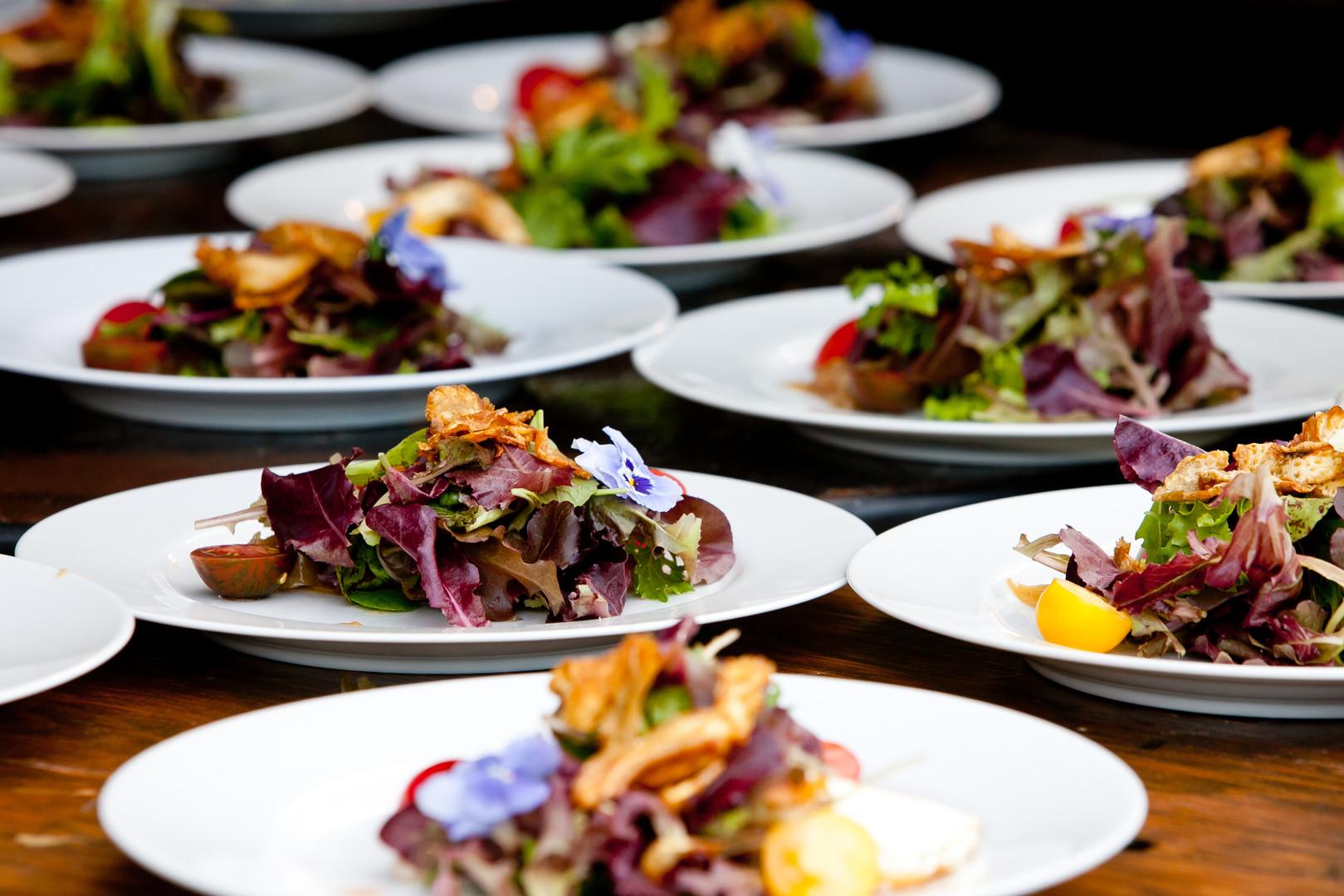 Salads on white plates