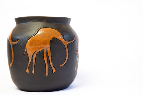 Black and brown African clay pot on an i